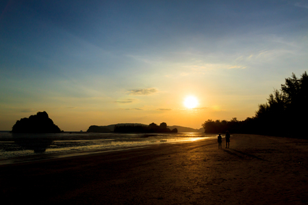 Silhouette sunset tropical beach