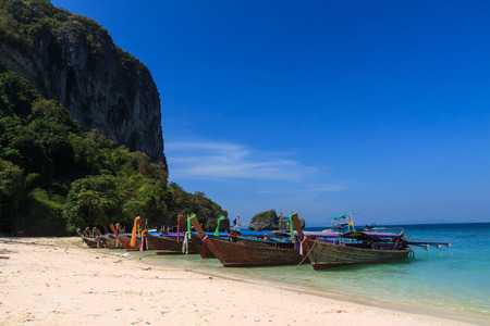 Long tail boat in front of twin sea island , Krabi Thailand
