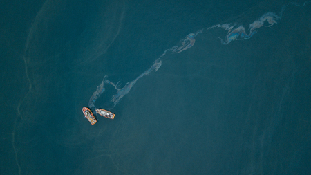 Aerial view of fishing boats polluting environment