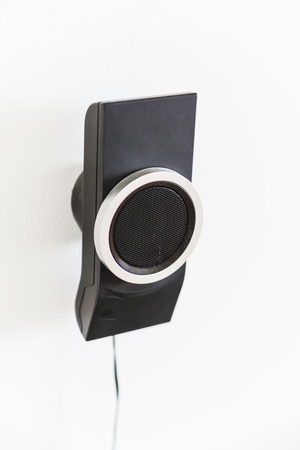 amp: Speaker mounted on a white wall. Part of the home theater 5 to 1.