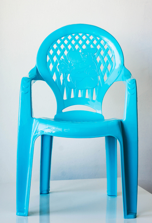 stool: Closeup of light blue child seat. Back holes with the elephant. Stock Photo