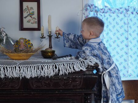 christmas costume: The boy in Russian national costume at the Christmas table