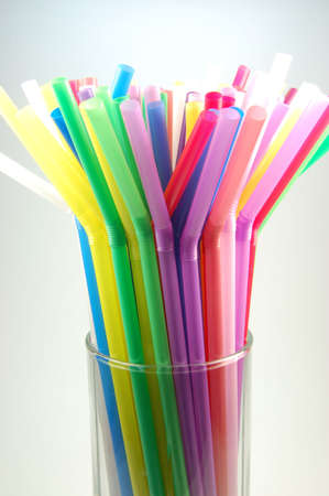 many color cocktail straws isolated on white