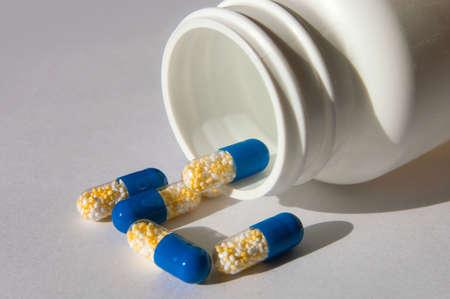 many capsules isolated on background Stock Photo