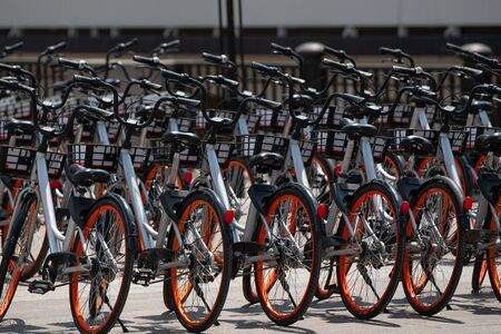 new modern rental bikes for exploring the city. filled bicycle parking. eco-friendly transport for the city