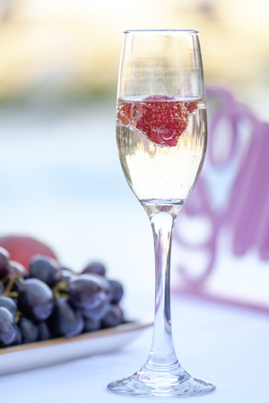 Champagne glass with berries