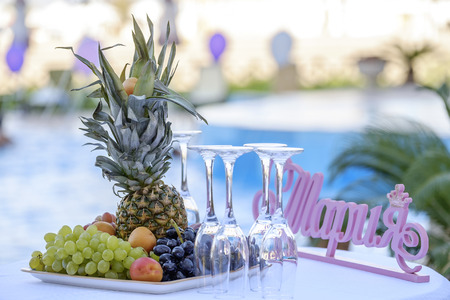 Exotic fruits and empty glasses on the table. Stock Photo