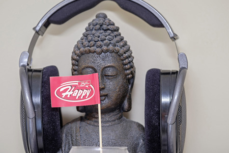 Buddha in headphones and be happy flag