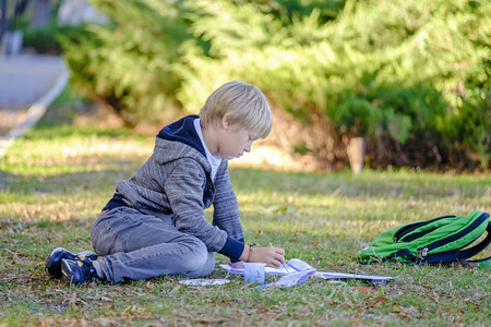 Kid draws a picture with watercolors in park 2 Stock Photo