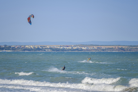 Kite surfers in black sea 写真素材