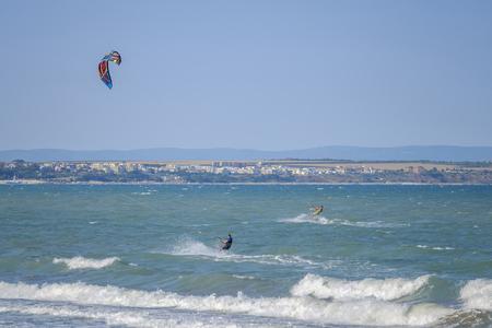 Kite surfers in black sea Banco de Imagens