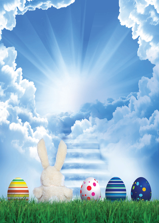 Easter bunny with eggs on the background of a stairway to heaven