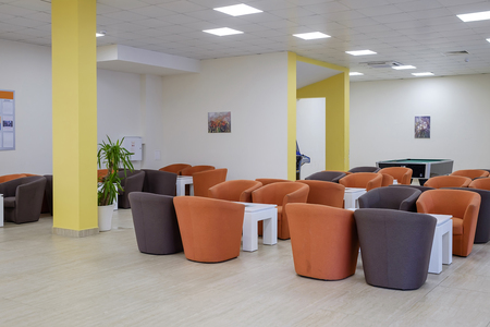 Modern bright hotel lobby with colorful chairs 2 Imagens