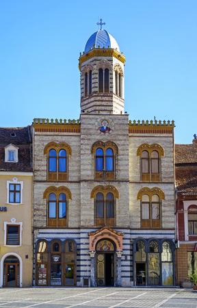 Christian church on main square in Brasov, Romania Stock Photo