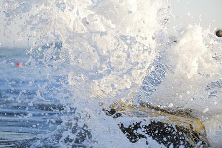 Splashing waves on the rock beach 2