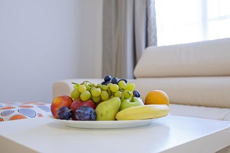 Fresh fruit plate on white table 2