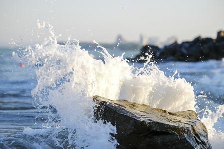 Splashing waves on the rock beach 1