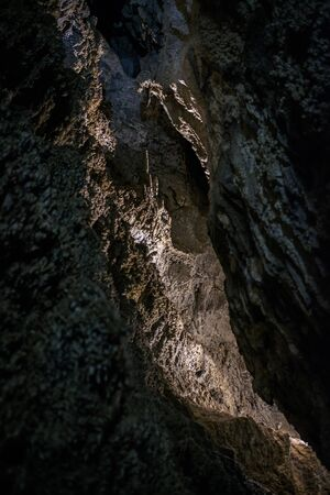 Passages covered with old stalactites and stalagmites inside the cave 1