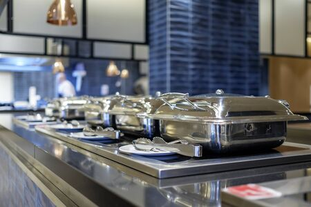 Professional metal kitchen equipment at buffet tables 6