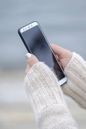 Woman holding a white smartphone close up 4 Stock fotó