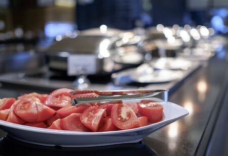 Cutted tomatoes at buffet in hotel restaurant 2