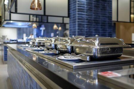 Professional metal kitchen equipment at buffet tables 7 Stock fotó