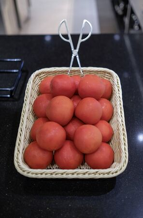 Whole tomatoes at buffet in hotel restaurant Stock fotó