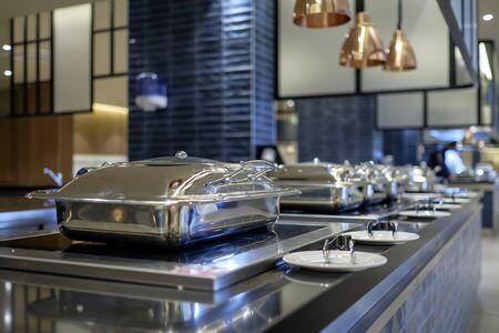 Professional metal kitchen equipment at buffet tables 3 Stock fotó
