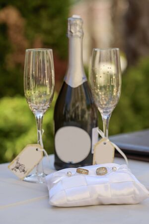 Wedding rings and champagne bottle