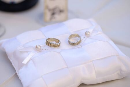 Wedding rings on a white pillow 4 Stock fotó