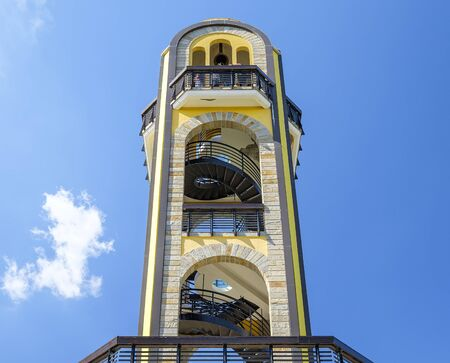 Yellow observation tower with blue sky background 2 Stock fotó
