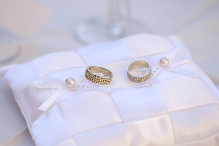 Wedding rings on a white pillow 2