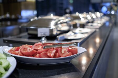 Cutted tomatoes at buffet in hotel restaurant 1 Stock fotó