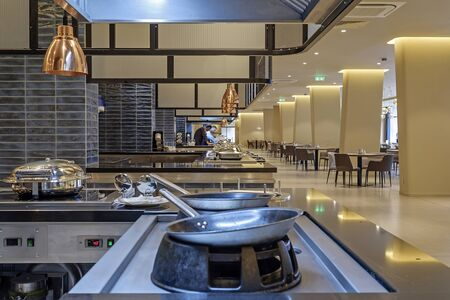 Professional metal kitchen equipment at buffet tables 1
