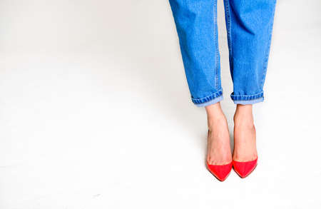 female legs in red shoes. Women's shoes on a white background.shoes that should not be worn