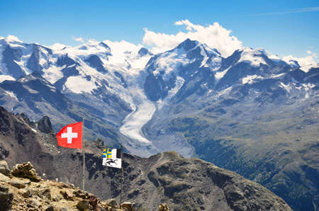view of the morteratsch glacier in engadin piz languard. Swiss alpine landscape. Piz Bernina, Piz Palu. Swiss Flag.