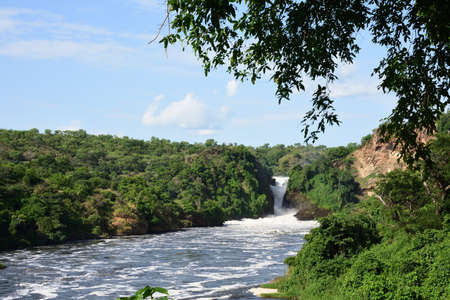 Murchison Falls National Park Uganda, Waterfall in beautiful green forest with white water, rocks, roaring water