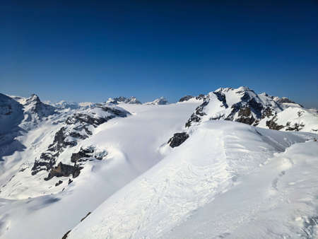 View from the mountain in glarus to a nice winter landscape in the swiss mountains.Claridenfirn and toedi piz russein