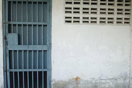 blue door: Blue door Wallpaper cement Stock Photo