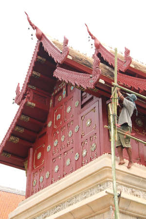 Man working for renovation of Thai temple