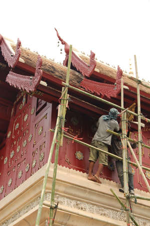 Thai workers working for renovation of Thai temple