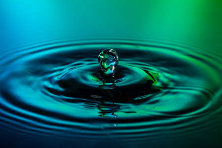blue green background: Water drop on green blue background macro