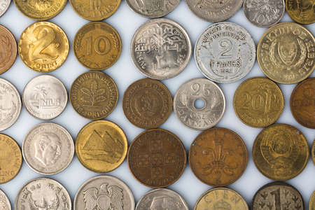 at close quarters: Closeup of many old coins on white background