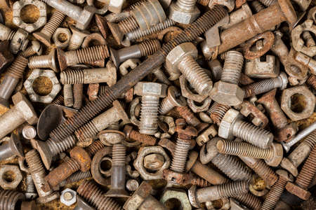 bolts and nuts: collection old rusty screw heads bolts nuts background