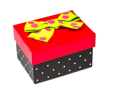 greem: Funny red and black gift box with green ribbon isolated on white background