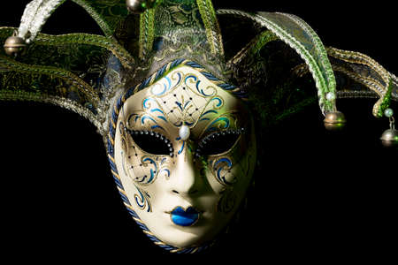 carnivale: Beautiful venezian souvenir mask with jingles on black background