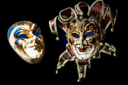 Venetian souvenir masks on black background isolated.