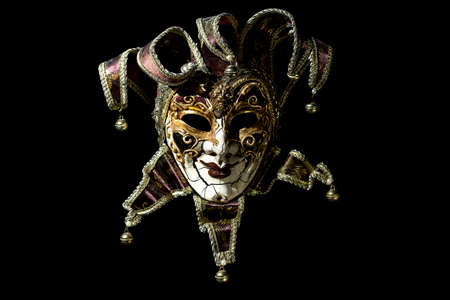Beautiful venetian souvenir mask on black background Stock Photo
