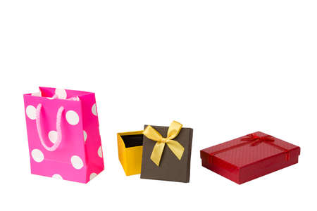 greem: Pink gift packet, red giftbox and yellow brown gift box with ribbon isolated on white background