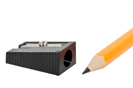 Black pencil sharpener and pencil close-up isolated on white background